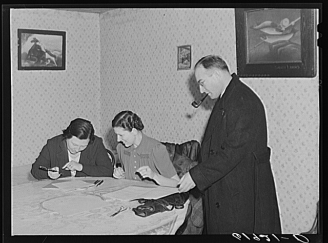 Home supervisor and county supervisor helping wife of FSA (Farm Security Administration) borrower with account book. Labette County, Kansas