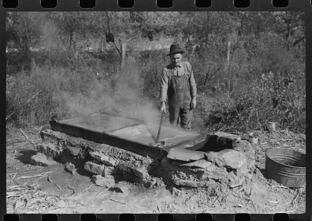 Homebuilt boiler pit made of mud and rocks where the sap from the sorghum cane is boiled down to the syrup.The man who does the cooking goes from one farmhouse to another and takes a share of the syrup for his work at the different mountaineers' homes in Breathitt County, Kentucky