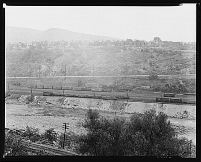 Homes of Upper Mauch Chunk as seen from East Mauch Chunk, showing the Lehigh River, the Lehigh Valley Railroad