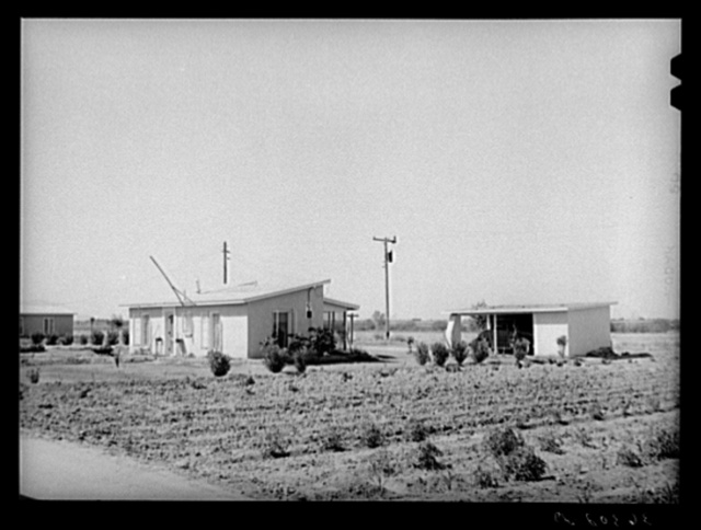 House and garage with garden in foreground at the Casa Grande Valley Farms. Pinal County, Arizona
