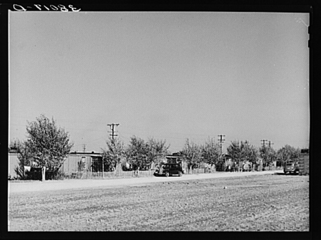 Houses for married couples fashioned from old boxcars. Earl Fruit Company ranch. Kern County, California
