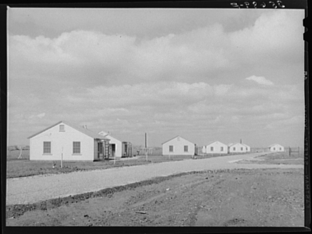 Houses for permanent agricultural workers at migratory labor camp. Robstown, Texas