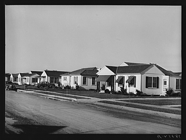 Houses in the Alameda residential section of Corpus Christi, Texas. These houses are about two years old and were built by people who came into Corpus Christi because of the oil boom, sea wall construction work, etc. This is the type of housing which is greatly needed for naval officers and their families who will be stationed at the naval air base. Corpus Christi, Texas