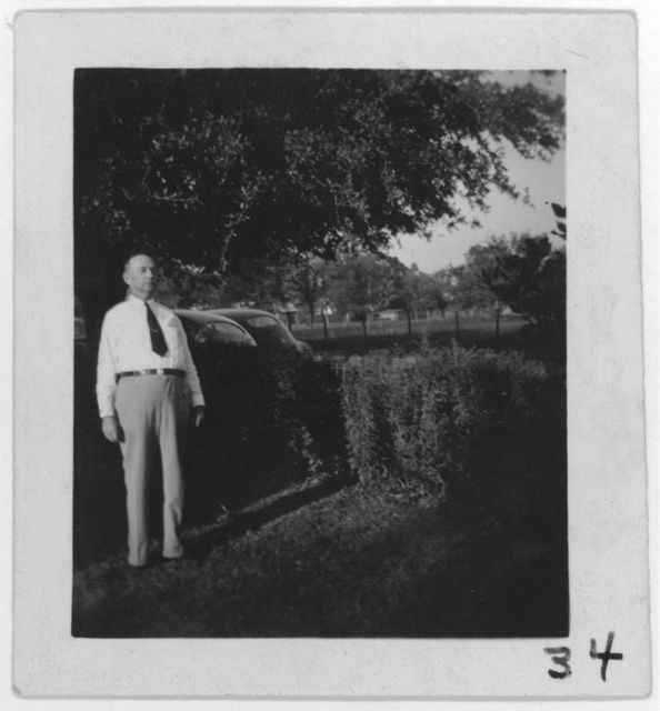 """[H.R. Weaver, singer of """"Ox-driving song,"""" at his home, Merryville, La.]"""