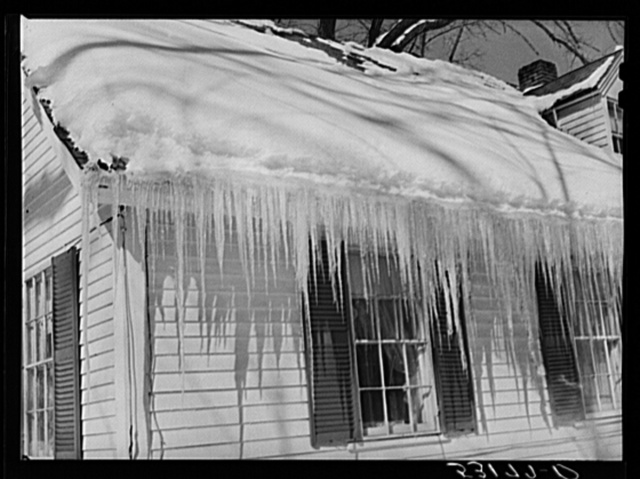 Icicles hanging from roof of house in Woodstock, Vermont
