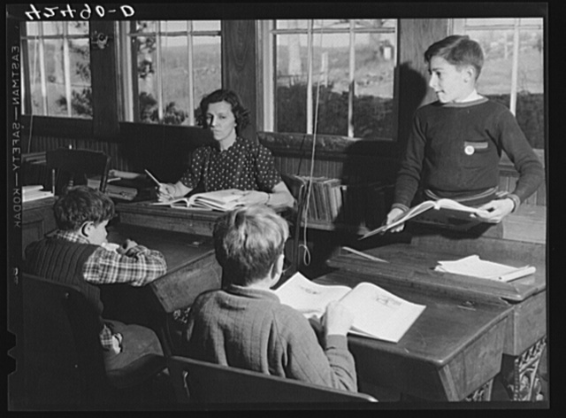 In a one-room schoolhouse in Ledyard, Connecticut. The teacher is Miss Holmes
