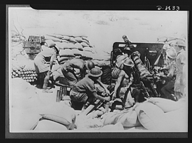 India in the war. Indian soldiers in action before the capture of Keren. This gun hurled approximately 24,000 shells a day. Note the shadow of camouflage on the field gun