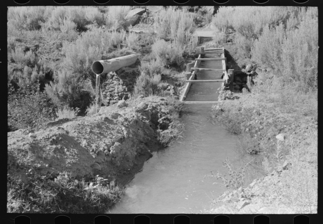 Irrigation ditch carried across an arroyo. Taos County, near Dixon, New Mexico