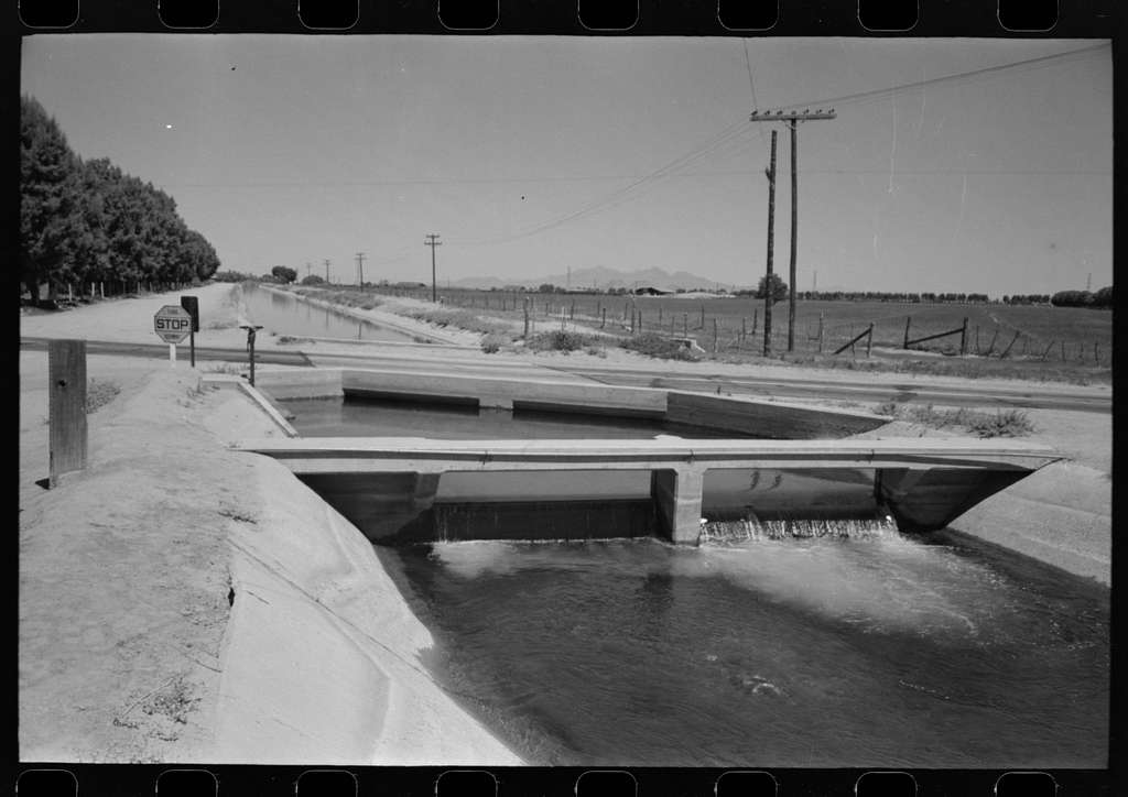 Irrigation ditch fed by water from deep-driven wells, Maricopa County, Arizona