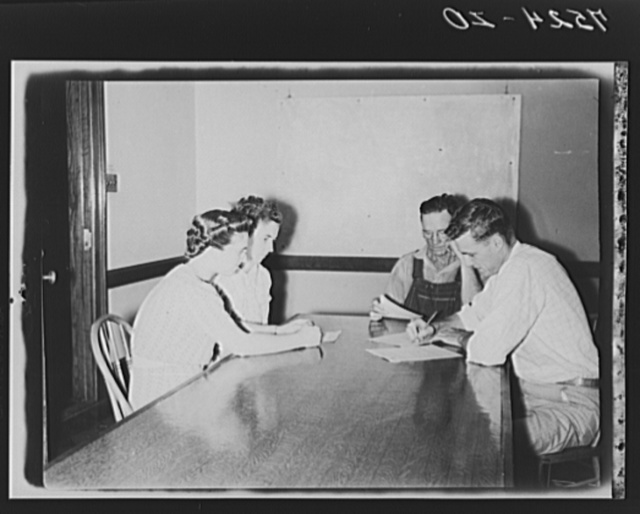 Jack Cowan, Farm Security Administration representative, Helen Warren, home supervisor, and Mr. and Mrs. Clarence Thornton, going over farm and home plans. Story County, Iowa