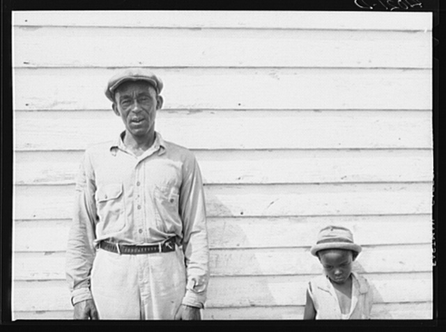 John Barnes, FSA (Farm Security Administration) client, and one of his children. Ridge, Maryland