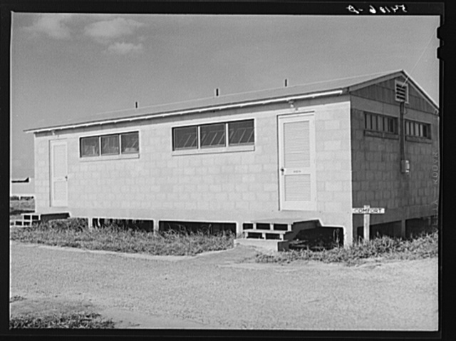 Large comfort stations, toilets and washroom are at each end of the shelter units. Osceola migratory labor camp, Belle Glade, Florida