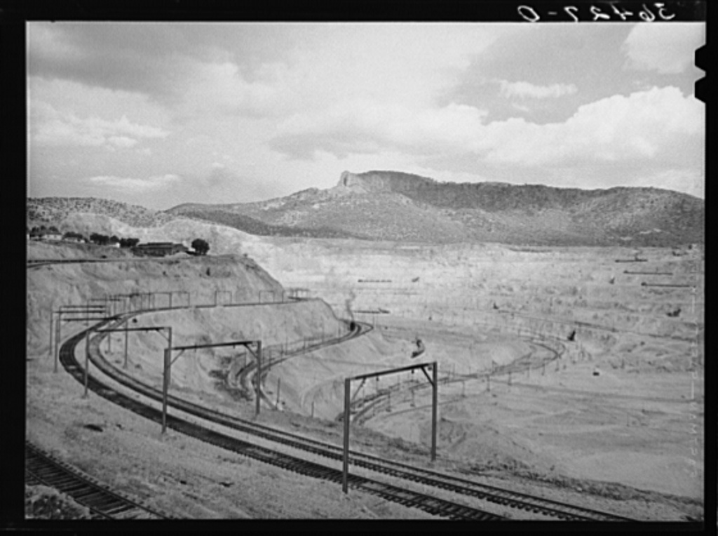 Largest open pit copper mine in the world at Santa Rita, New Mexico. Copper was discovered here by an officer of the Spanish army in 1800 who sold the same to a wealthy Spanish merchant. Pure native copper was transported by pack mule to Mexico City to enter the royal mint for coinage. In 1900 a young mining engineer became interested in the development and was instrumental in the ultimate success of the Chino Copper Company. The ore is now shipped to Hurley, a short distance to the south, where it is put through a five million dollar smelter