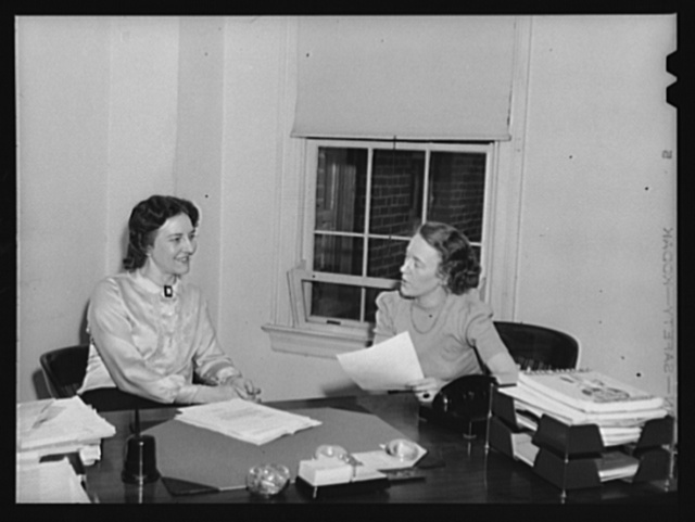 Left: Loda Mae Davis, assistant to the chief, Consumer Contacts Section, Consumer Division, Office for Price Administration (OPA). Former association: instructor in Consumer Problems, San Mateo Junior College; author, lecturer. Right: Jean Holmes, clerical assistant, Consumer Division, OPA. Former association: U.S. Department of Agriculture