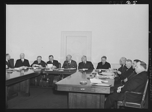 Left to right: Walter C. Teagle, former President, Standard Oil Company of New Jersey; Charles v. McLaughlin, Undersecretary of Labor; Frank P. Graham, University of North Carolina President; Sidney Hillman, Associate Director General representing the Office of Production Management (OPM); Clarence A Dykstra, Chairman; Daniel Tracy, Second Assistant Secretary of Labor; William H. Davis, Vice-Chairman, new Mediation Board, formerly Chairman, New York State Mediation Board; Philip Murray, CIO (Congress of Induatrial Orgamizations) President; Thomas Kennedy, Secretary-Treasurer, United Mine Workers (UMW); George M. Harrison, grand president, Brotherhood of Railway and Steamship Clerks; George Meany, general secretary of the AFL (American Federation of Labor)
