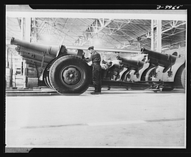 Lend-Lease to Britain. A shipment of 155 mm. howitzers just arrived from the United States under lend-lease is prepared for service at an ordnance depot in England