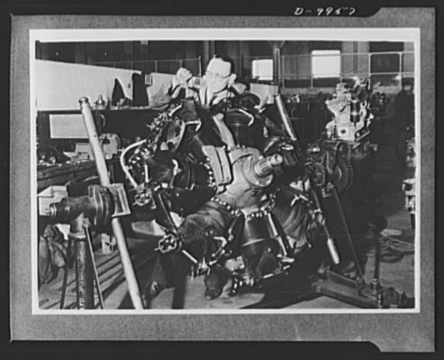 """Lend-Lease to Britain. A """"Whirlwind"""" radial airplane engine shipped by the United States as lend-lease is assembled at an ordnance depot in the English Midlands"""