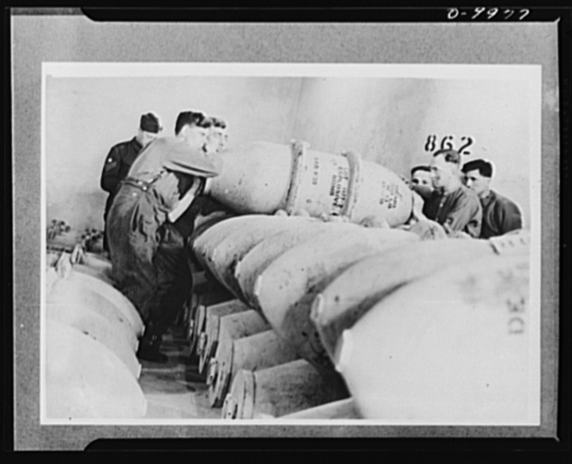 Lend-Lease to Britain. American 1,100-pound bombs to be used by the Royal Air Force are stacked in an ammunition dump in England, after arriving from the United States in a lend-lease shipment. The dump is in a tunnel one hundred feet underground hewn from solid rock