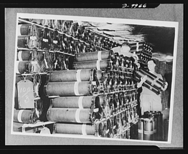 Lend-Lease to Britain. American-made 155 mm. shells shipped from the United States as lend-lease, are stacked in an ammunition dump hewn from solid rock one hundred feet below the surface in England