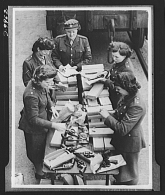 Lend-Lease to Britain. American-made 38-caliber revolvers shipped to England from the United States under lend-lease are unpacked at an English ordnance depot