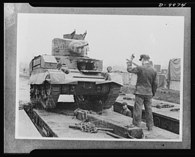 Lend-Lease to Britain. An American light tank is unloaded at a central ordnance depot in England, part of a lend-lease shipment from the United States