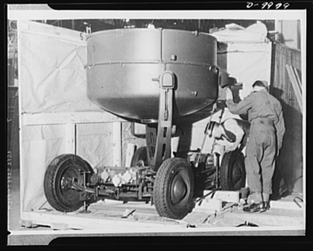Lend-Lease to Britain. An American-made searchlight, shipped from the United States to England as lend-lease, is unpacked at an ordnance depot on its way to service