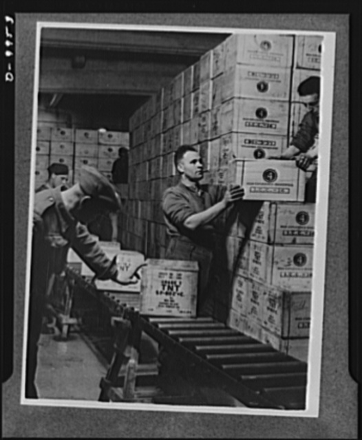 Lend-lease to Britain. Cases of TNT gun powder shipped from the United States under lend-lease are stacked in the dump in a tunnel one hundred feet underground dug out of solid rock, in western England. The staff here works twenty-four hours a day handling lend-lease materials arriving from the United States