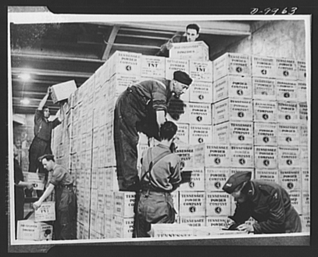 Lend-Lease to Britain. Cases of TNT gunpower shipped from the United States under lend-lease are stacked in the dump in a tunnel one hundred feet underground dug out of solid rock in western England. The staff here works twenty-four hours a day handling Lend-Lease materials arriving from the United States