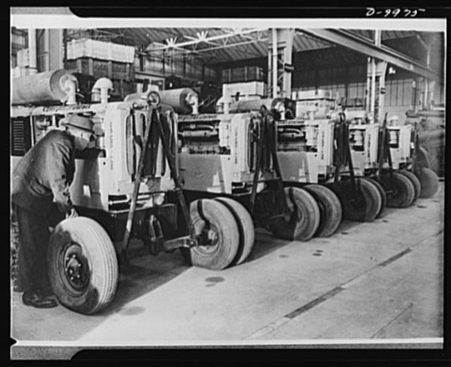 Lend-Lease to Britain. Diesel searchlight generator sets, just arrived in England from the United States as part of a lend-lease shipment, are made ready for issue
