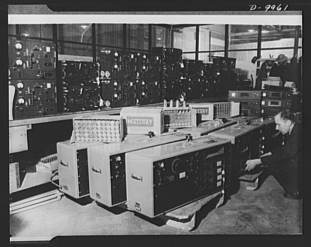 Lend-Lease to Britain. Radio outfits shipped from the United States under lend-lease arrive at an ordnance depot in England. They include reception sets spare valves and (on shelf) American tank radio sets