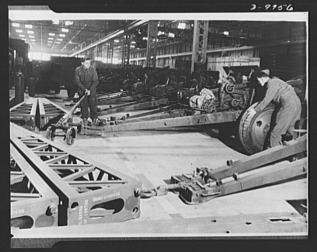 Lend-Lease to Britain. Shipment of 75 mm. guns from the United States as part of a lend-lease shipment reaches an ordnance depot in the English Midlands and are prepared for service