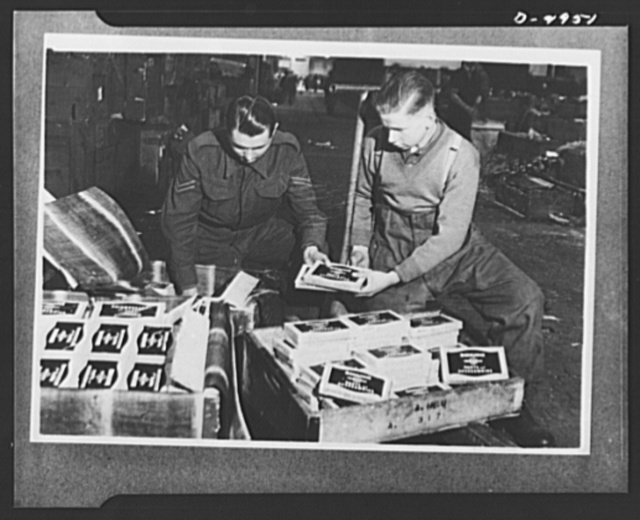 Lend-lease to Britain. Spare parts of an American-made motorcycle shipped to England as lend-lease are unpacked at an ordnance depot