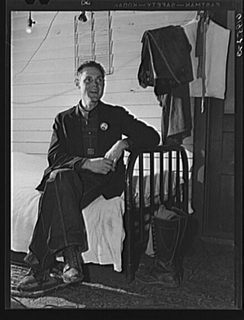 Leo Donathon, laborer at plant, in his improvised bedroom at Mrs. Pritchard's house. Radford, Virginia