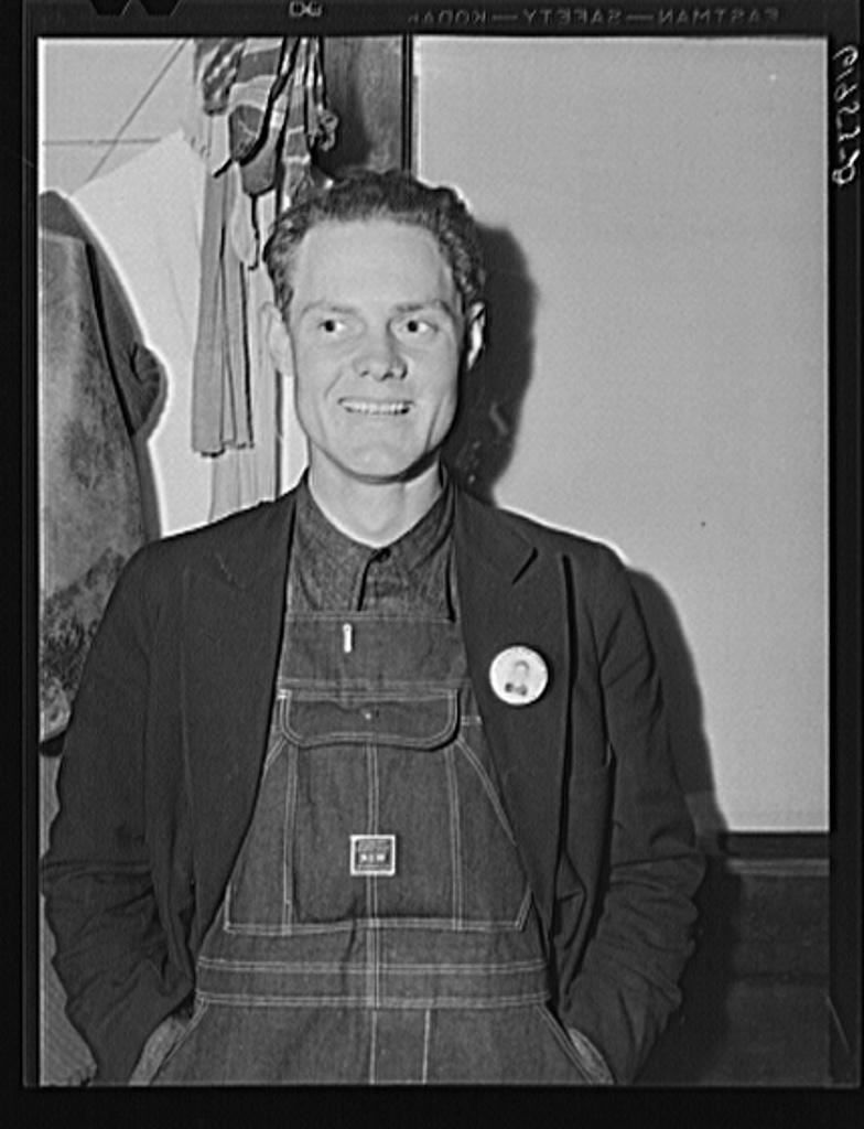 Leo Donathon wearing his identification badge for Hercules powder plant. Radford, Virginia