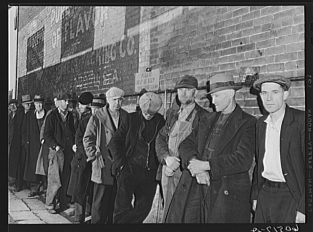 Line of men waiting in alley outside city mission. They are waiting for the meal which will be served at 5:00 p.m. Dubuque, Iowa
