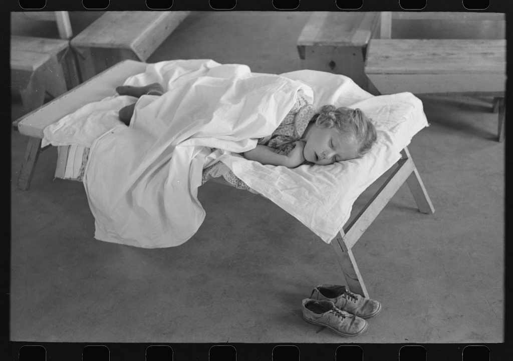 Little girl taking her nap at the Work Projects Administration nursery school at the Casa Grande Valley Farms, Pinal County, Arizona