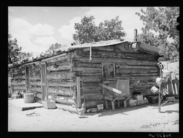 Log house built by a homesteader. This homesteader, who was deeded his farm four years ago, is now sick and lives in town, renting his house and farm to a young couple. Pie Town, New Mexico