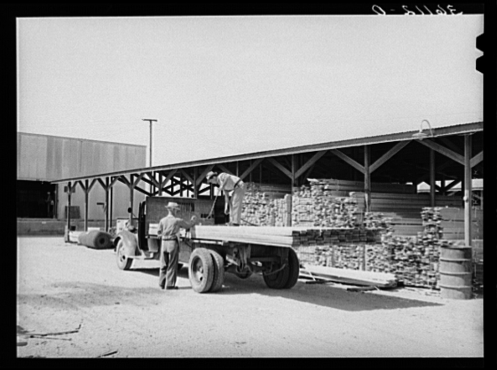 Lumber being loaded onto truck at the Producers and Consumers Cooperative. Phoenix, Arizona