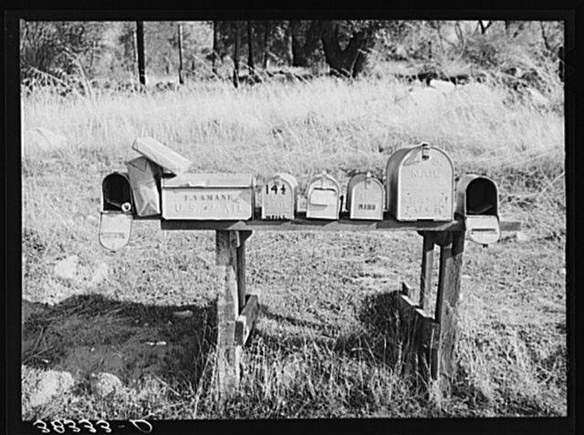 Mail boxes near Auburn, California. Notice the Japanese name. The Japanese are moving into this section on a subsistence farming basis as the older settlers who have not adjusted themselves to changing market conditions move out. Placer County, California