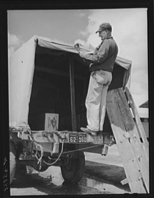 Man repairing truck. Returning to Oklahoma. Tulare migrant camp. Visalia, California