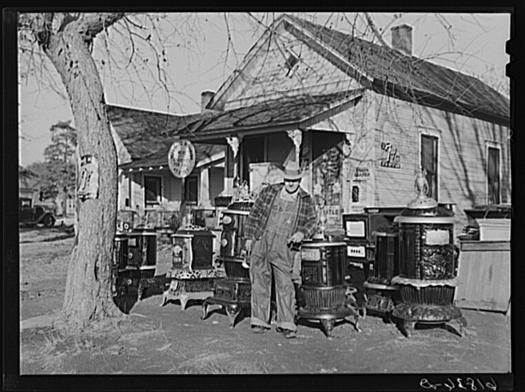Man who operates small grocery store and secondhand furniture store in his home. Chanute, Kansas