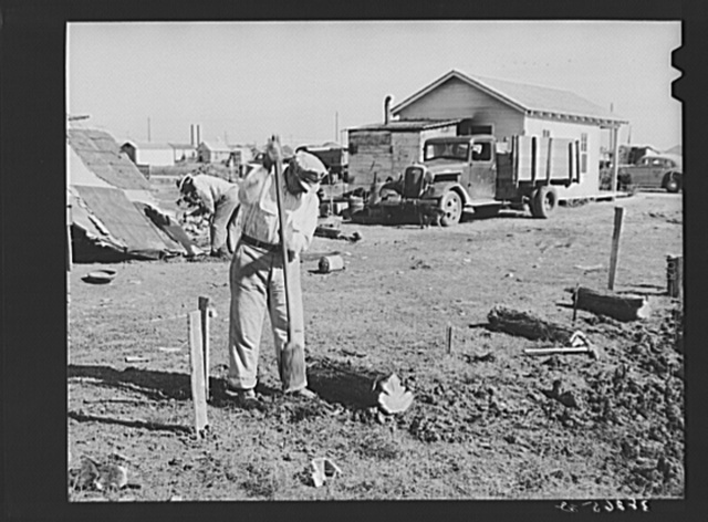Man working on foundation for new house in cheap residential section of Corpus Christi, Texas. Many cheap houses are now being built to satisfy the demand of workmen and their families for housing