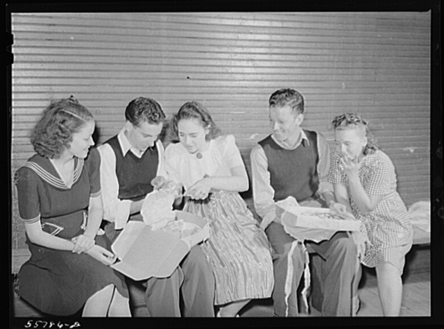 """Many parents and young people from the school and nearby communities attend the pie and box supper, given by the school to raise money for additional repairs and supplies. Each box or pie is auctioned off to the highest bidder, sometimes bringing a good deal, since the girl's """"boyfriend"""" usually wins and has the privilege of eating it with her afterwards. Quicksand School, Breathitt County, Kentucky"""
