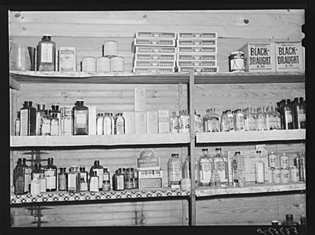 Medicine and drug shelf in country store which has doctor's office in rear. Faulkner County, Arkansas