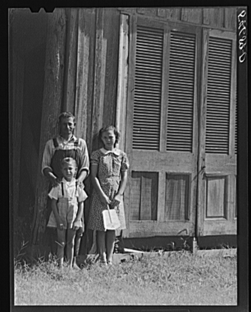 Melrose, Natchitoches, Louisiana. Mulatto servant with two of his children in front of home originally built by mulattoes. John Henry cotton plantation