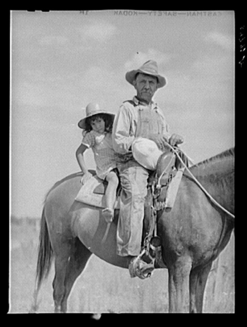 Melrose, Natchitoches Parish, Louisiana. Mulatto returning home after buying supplies at country store