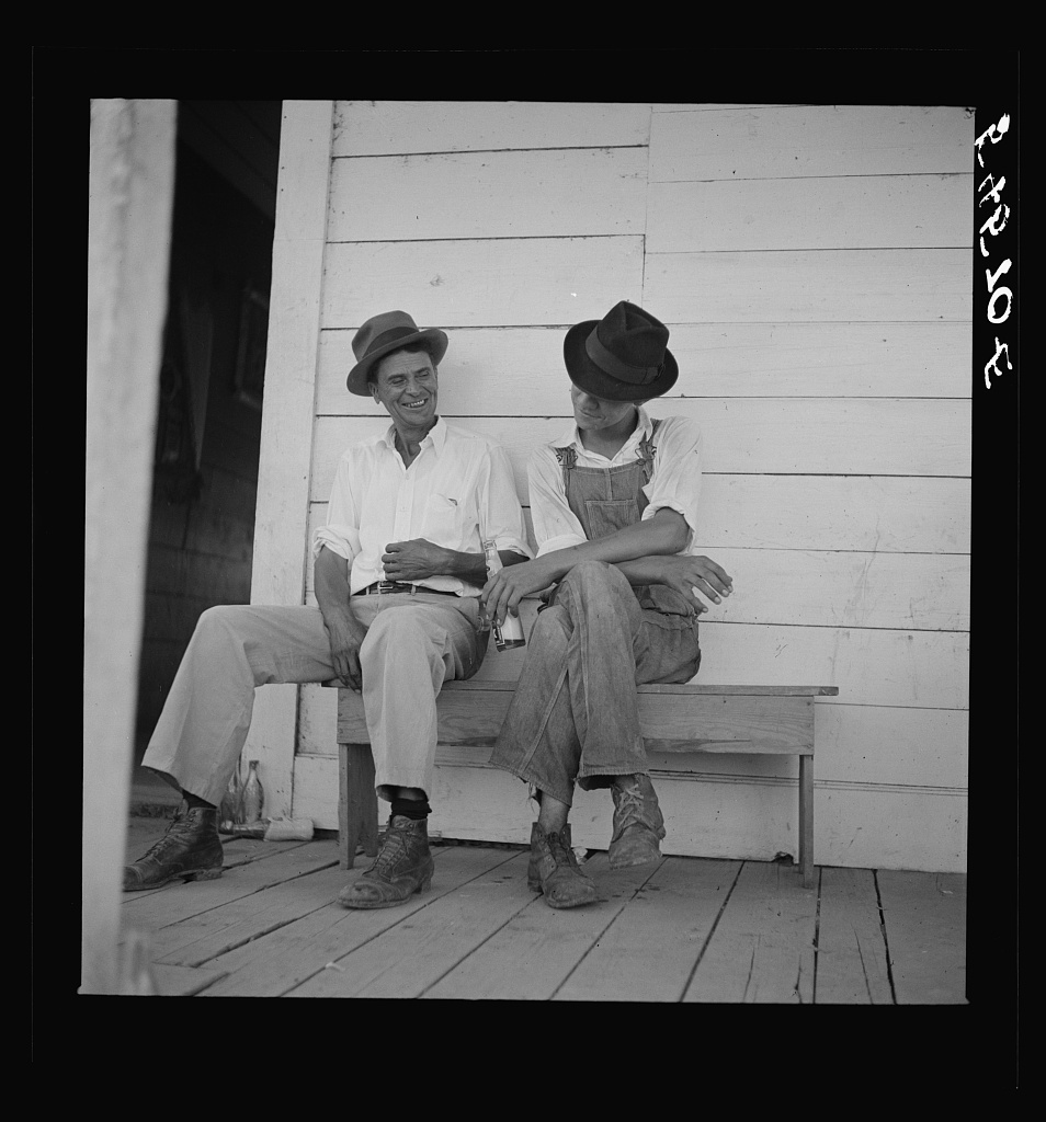 Melrose, Natchitoches Parish, Louisiana. Mulattoes sitting on the porch of country store and bar near John Henry cotton plantation