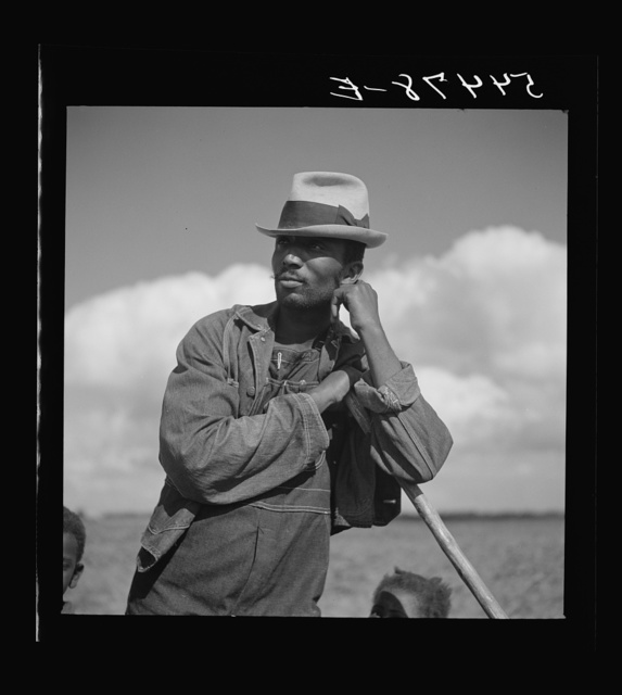 Member of Allen Plantation cooperative association resting while hoeing cotton. Near Natchitoches, Louisiana