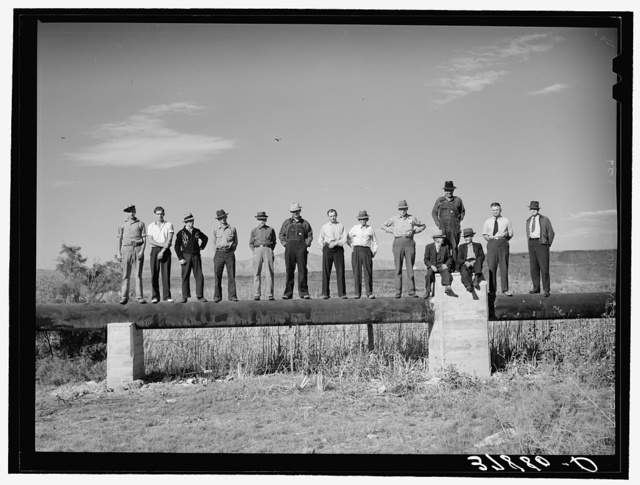 Member of FSA (Farm Security Administration) cooperative pipe line used for irrigation purposes. Saint George, Washington County, Utah