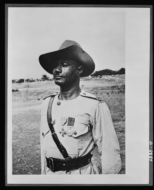 Member of the Order of the British Empire. Decorated for continuous gallantry and devotion to duty while under fire in the East African campaign, Regimental Sergeant Major LIanyier Dagarti of the Gold Coast Regiment, Royal West African Frontier Force, was the first Gold Coast soldier to receive the M.B.E (Member of the Order of the British Empire) in this war. His magnificent example of coolness and courage inspired in his batallion into action at Bulo Erillo and Uodors. Nineteen years in the service he holds Good Conduct and Long Service medals